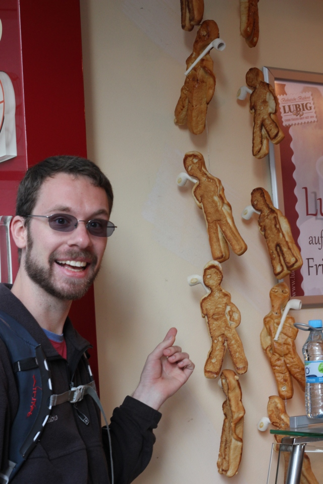 We stopped by a little bakery for breakfast. This is Jon, pointing to some strange little human-shaped pastries.