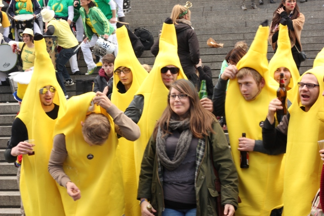 Groups of people in matching costumes seem to be the thing here. Here is a random tourist getting her picture taken with a group of bananas.