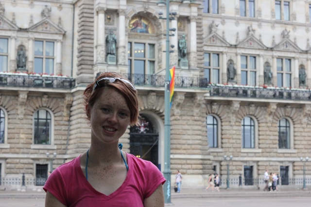 Me standing in front of Das Verdammte Rathaus. Note the pride flag they hung above the entrance!
