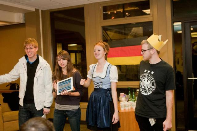 "#THROWBACKTHURSDAY: Junior Sam Woffard (center left) and sophomore Alison Haywood (center right) teach students ""Ein Prosit,"" a well-known German drinking song during Around the World on November 16th, 2011. Around the World was an event allowing students to learn about cultures of different countries. Photo by Igor Strupinsky."