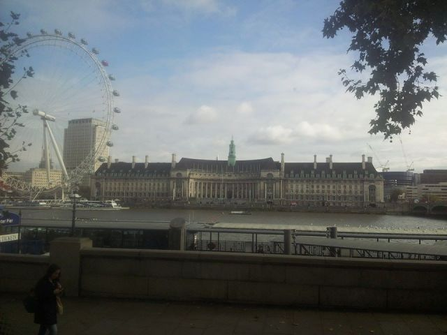 London county house and London Eye, as seen from a bus window.