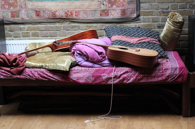 Cozy guitars all tucked into bed