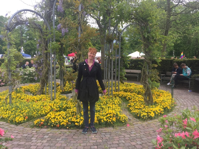 Alison posing in front of a small garden in Officierspladsen at Aarhus, Denmark