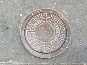 A manhole cover with the Aarhus coat of arms in Aarhus, Denmark