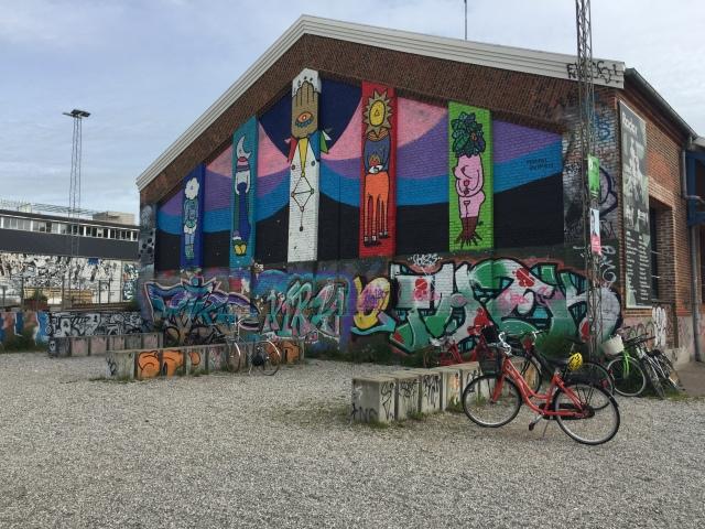 A graffiti-covered wall of Radar club at Godsbanen cultural center in Aarhus, Denmark